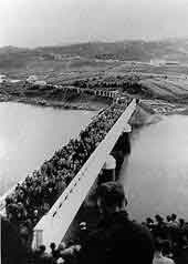 Crowd Crossing the Bridge